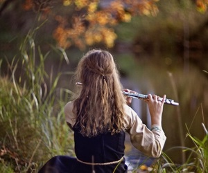 young woman, flute player, and girl by the river image