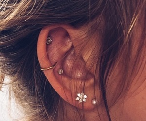 ear piercings, cartilage piercings, and upper ear lobe piercings image