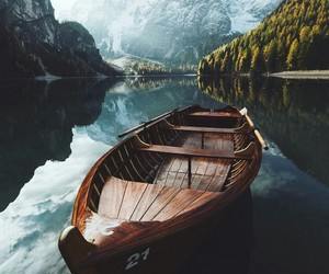 lake, mountains, and boat image