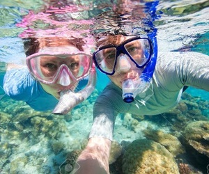 couple and snorkeling image