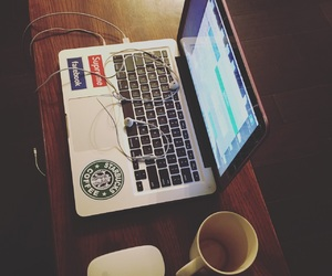 coffee, macbook pro, and earbuds image