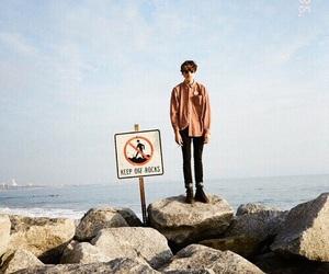 boy, rock, and sea image