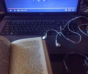 book, laptop, and earpods image