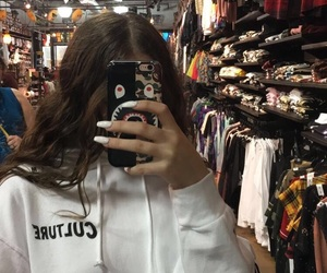 brunette, hoodie, and iphone image