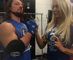 AJ, flair, and wrestlers image