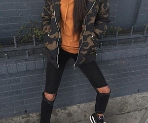 camo jacket, black vans sneakers, and black ripped jeans image