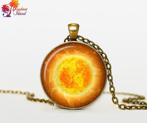 jewelry, necklace, and sun image