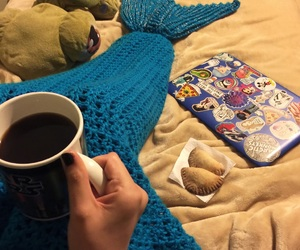 blankets, laptop, and blue image