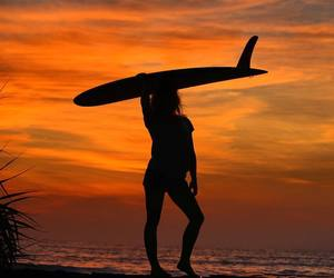 sunset, surfer, and surfing image
