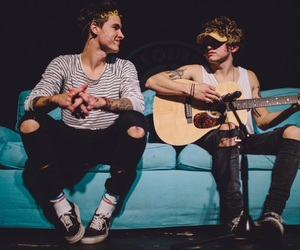jc caylen, kian lawley, and guitar image