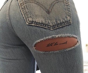 jeans, ripped jeans, and tattoo image