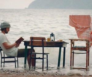 book, sea, and alone image