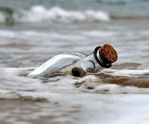 ocean and message in a bottle image