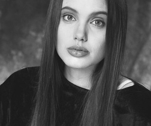 Angelina Jolie, black and white, and young image