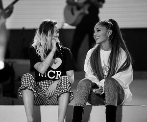 miley cyrus, ariana grande, and one love manchester image