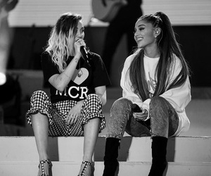 ariana grande, miley cyrus, and one love manchester image