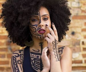 body paint, curly afro, and face paint image