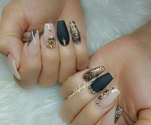 beige, black, and gold image