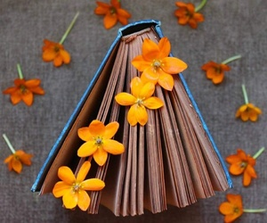 book, flower, and orange image