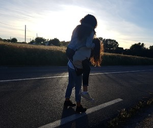 road, sunset, and sisters image