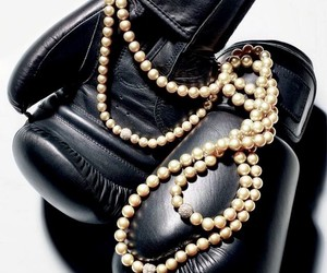 boxing gloves, pearls, and tough but girly image