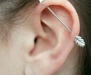 ear, piercing, and arrow image