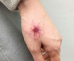 flower tattoo, pale, and hand tattoo image