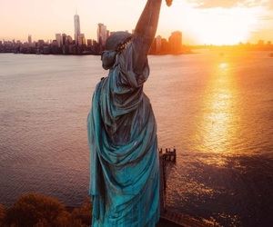 new york, statue of liberty, and sunrise image