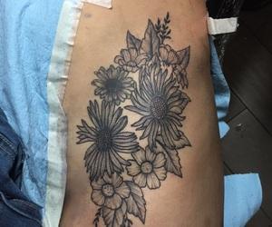 flower tattoo, tattoo, and hip tattoo image