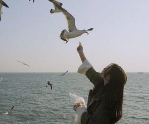 girl, bird, and ocean image