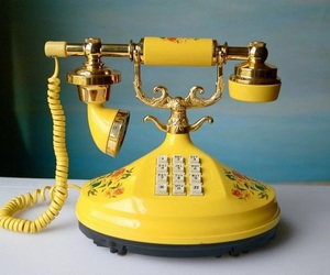 yellow, phone, and flowers image