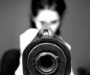 gun and black and white image
