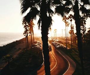 road, sun, and sea image