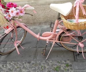 bycicle, pink, and cars image