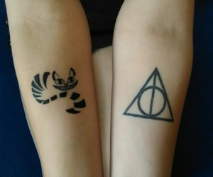 Cheshire cat, deathly hallows, and hogwarts image
