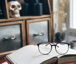 book, glasses, and library image