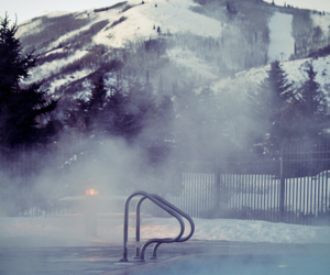 mountains, pool, and snow image