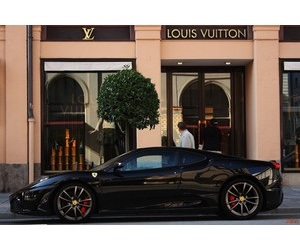 Louis Vuitton and car image