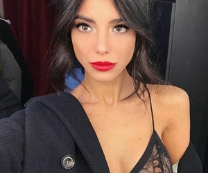 cat eye, contouring, and red lips image