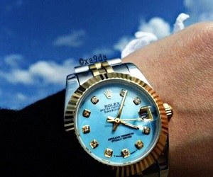 black, clouds, and rolex image