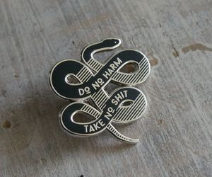 black, pin, and snake image