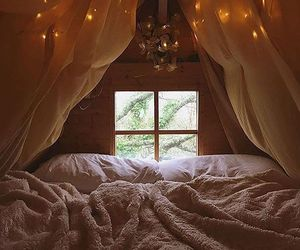 blanket, lights, and room image