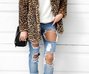 black purse, light blue ripped jeans, and cheetah fur coat image