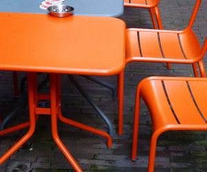 orange and tables and chairs image