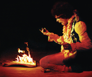 Jimi Hendrix, guitar, and fire image