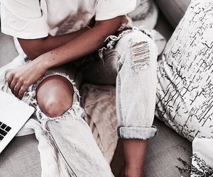 black, tan, and blue ripped jeans image