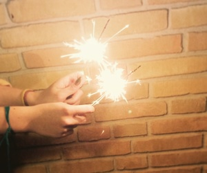 fireworks, gold, and sparkles image