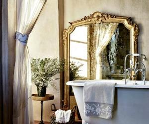 bathroom, mirror, and bathtub image