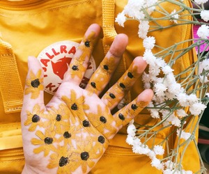 yellow, flowers, and hand image