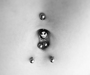 belly button, nipple piercing, and tongue piercing image